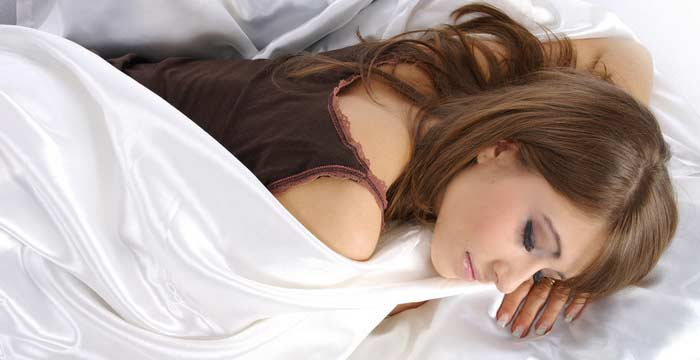 Beautiful sleeping girl in bed.